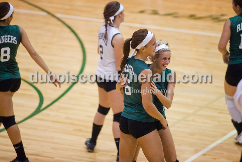 Rachel Mummey/The Herald<br /> Forest Park's Katie Fischer and Sydney Berg embraced after a point earning play in their match against South Spencer in Ferdinand on Monday. Forest Park won three of four sets, in which they scored 25-11, 20-25, 25-14, and 27-25.