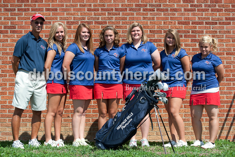 Members of the Heritage Hills girls' golf team are, from left: coach Dave Jochim, Dallas Buse, Julie Heltzel, Eryn Jochim, Ashleigh Gideon, Sarah Ayer, Madison Lowry.