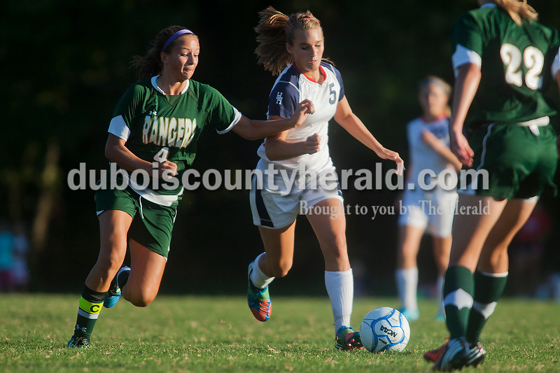 Rachel Mummey/The Herald<br /> Forest Park's Megan Grundhoefer battled against Heritage Hills' Adrianna Oxley to gain control of the ball during their game in Lincoln City on Tuesday evening. Heritage Hills won 3-1.
