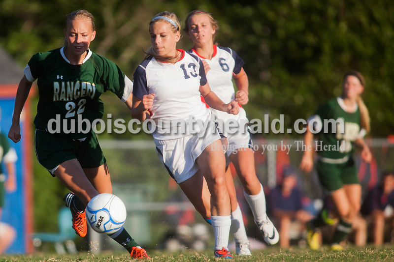Rachel Mummey/The Herald<br /> Heritage Hills' Karaline Staggs and Paige Priest raced to get possession of the ball against Forest Park's Abby Tempel during their game in Lincoln City on Tuesday evening. Heritage Hills won 3-1.