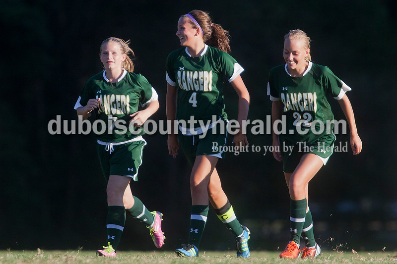 Rachel Mummey/The Herald<br /> Forest Park's Morgan Zehr, Megan Grundhoefer and Abby Tempel celebrated after scoring their only goal against Heritage Hills during during their game against Heritage Hills in Lincoln City on Tuesday evening. Heritage Hills won 3-1.
