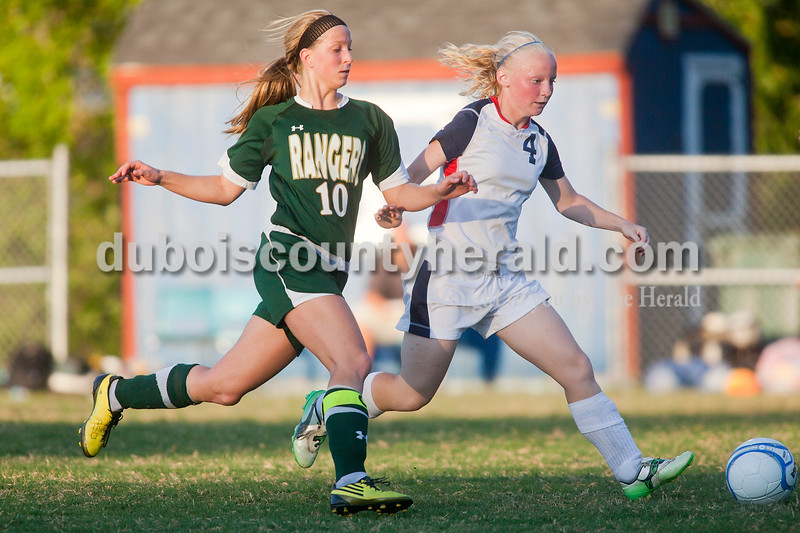 Rachel Mummey/The Herald<br /> Heritage Hills' Rebecca Mercker and Forest Park's Amanda Jacob ran to gain possession of the ball during their game in Lincoln City on Tuesday evening. Heritage Hills won 3-1.