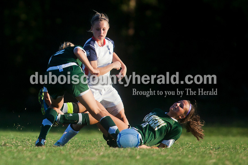 Rachel Mummey/The Herald<br /> Forest Park's Megan Grundhoefer and Madison Knies fell after getting tangled in fight for the ball against Heritage Hills' Breigh Haase during their game in Lincoln City on Tuesday evening. Heritage Hills won 3-1.