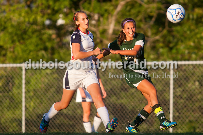 Rachel Mummey/The Herald<br /> Heritage Hills' Adrianna Oxley and Forest Park's Megan Grundhoefer raced to gain control of a loose ball during their game in Lincoln City on Tuesday evening. Heritage Hills won 3-1.