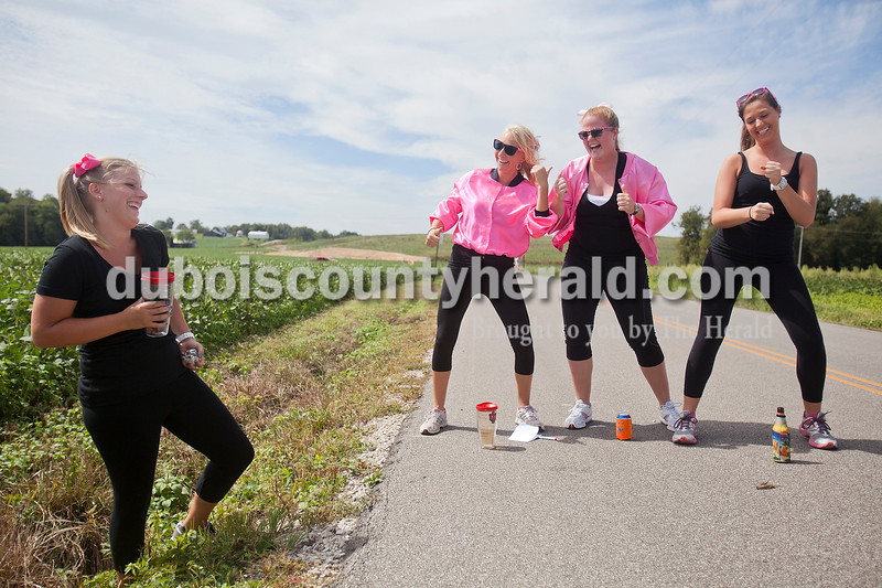 Rachel Mummey/The Herald<br /> Pink Ladies Kate Brosmer, Abby Bartley, Courtney Schnaus, all of Ireland, did the hand jive as their teammate Adelye Seng of Ireland fetched their ball our of the ditch during the Third annual Irish Road Bowling competition in Ireland on Saturday.
