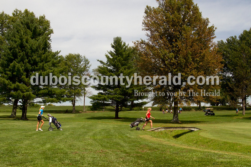 Olivia Corya/The Herald<br /> Southridge's Ally Bounds walked across the fairway during the IHSAA Sectional at the Jasper Municipal Golf Course on Saturday.