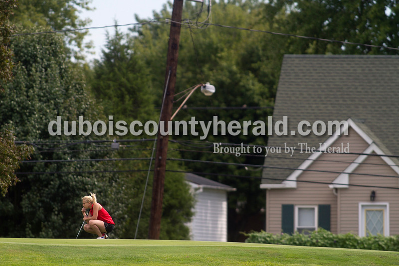 Olivia Corya/The Herald<br /> Southridge's Jessica Oser sized up her shot on the putting green during the IHSAA Sectional at the Jasper Municipal Golf Course on Saturday.