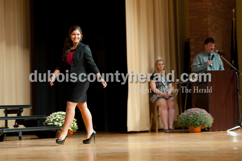 Olivia Corya/The Herald<br /> Joanna Hildebranski of Huntingburg, 16, showed off her business attire during the Herbstfest Queen Pageant in the Southridge High School auditorium on Sunday. Behind her were last year's queen Alicia Begle of Huntingburg, 18, and emcee Chris James of Ferdinand.