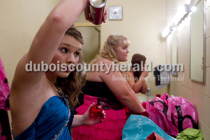 Olivia Corya/The Herald<br /> Contestant Heather Deel of Huntingburg, 17, spritzed some hair spray as she got ready backstage for the formal wear portion of the Herbstfest Queen Pageant at Southridge High School along with Rhea Fuhrman of Huntingburg, 17, center, and Joanna Hildebranski of Huntingburg, 16, on Sunday. Heather was this year's second runner up, and Rhea was this year's queen.