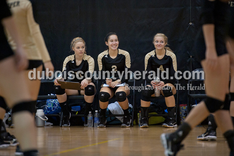 Olivia Corya/The Herald<br /> Jasper's Andrea Weidenbenner, Elisabeth Ahlbrand, and Lydia Scherle, left to right, watched their teammates play against Evansville Memorial High School during the Jasper invitational at Jasper High School on Saturday.