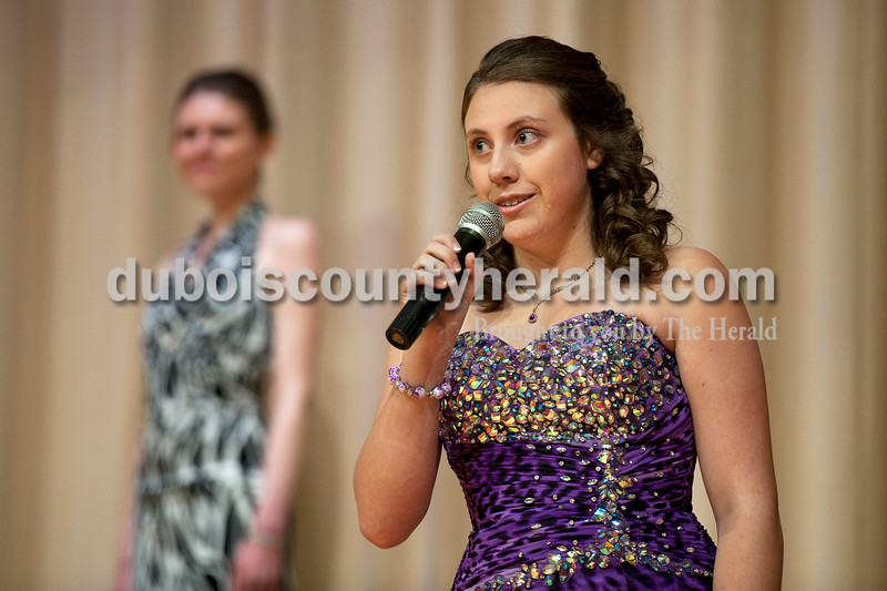 Olivia Corya/The Herald<br /> Heather Underhill of Huntingburg, 18, answered her interview question on stage during the Herbstfest Queen Pageant as her sister Stephanie Underhill, 21, also a contestant, watched in the Southridge High School auditorium on Sunday.