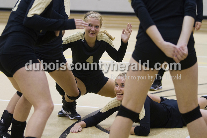 Olivia Corya/The Herald<br /> Jasper's Lydia Scherle, No. 4, and Abby Rogers, lying down, played a game called ninja with other teammates while they waited between matches during the Jasper invitational at Jasper High School on Saturday.