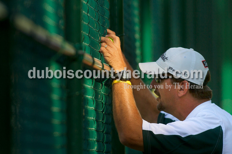 Olivia Corya/The Herald<br /> Forest Park tennis coach Dean Blessinger gave advice to one of his players during a match at Forest Park on Tuesday.