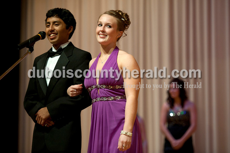 Olivia Corya/The Herald<br /> Haley Langebrake of Holland, 16, walked on stage escorted by Irvin Rocha of Huntingburg, 18, before the winners were announced during the Herbstfest Queen Pageant in the Southridge High School auditorium on Sunday.