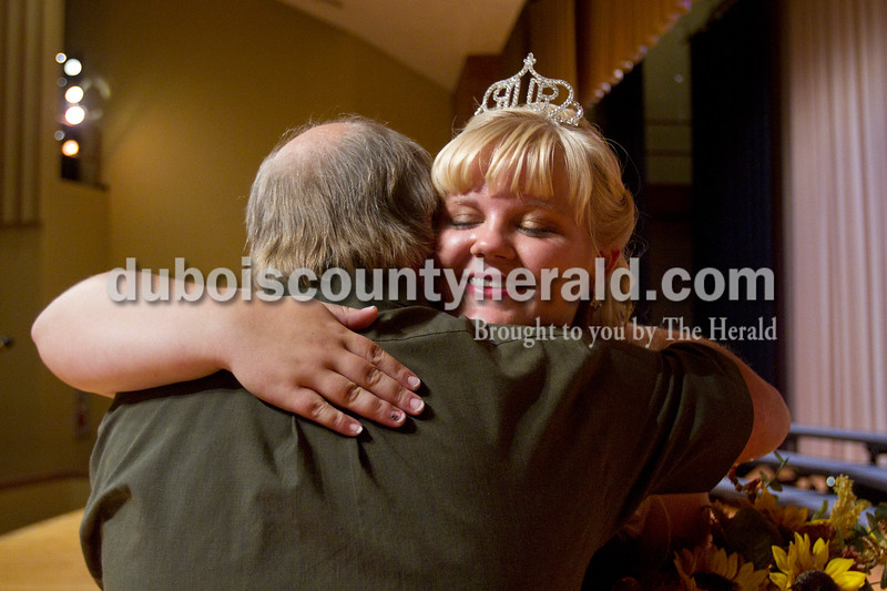 Olivia Corya/The Herald<br /> 2012 Miss Herbstfest Queen Rhea Fuhrman of Huntingburg, 17, hugged her father Randy after she was crowned at the Herbstfest Queen Pageant in the Southridge High School auditorium on Sunday.