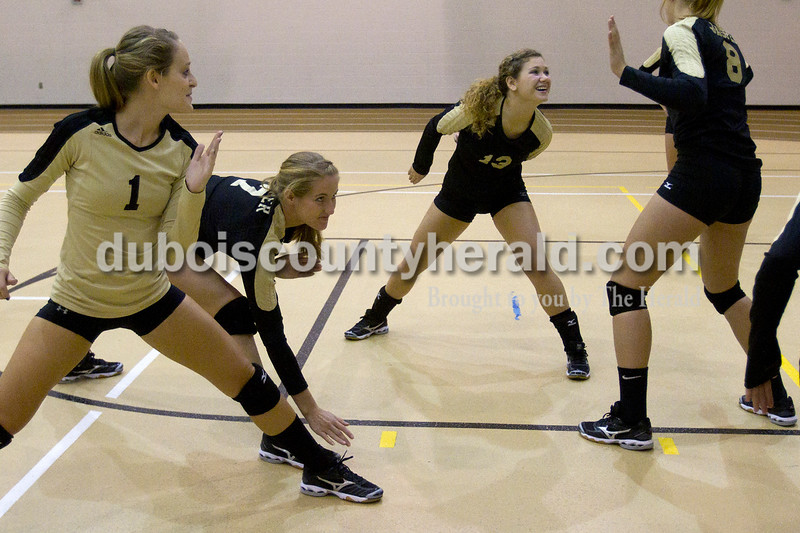 Olivia Corya/The Herald<br /> Jasper's Jaclyn Schmitt, Abby Rogers, Mariah Moeller, and Tori Sermersheim, left to right, played a game called ninja with other teammates while they waited between matches during the Jasper invitational at Jasper High School on Saturday.