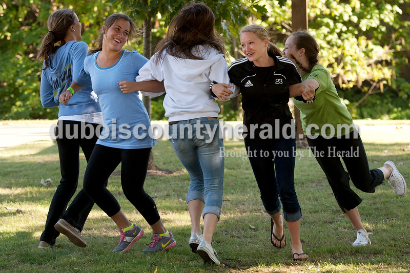 Olivia Corya/The Herald<br /> Allie Wood, 14, Emma Seger, 15, Kiersten Lorui, 16, and sisters Julia Ariens, 15, and Annie Ariens, 17, left to right, all of Jasper, danced to country tunes from a live band at the sixth annual Riverwalk Taster's Fest, a fundraiser for Anderson Woods camp, in Jasper on Saturday. Anderson Woods is a camp with people for mental or physical disabilities.