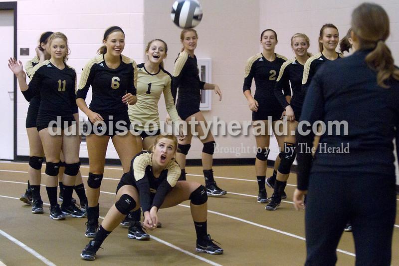 Olivia Corya/The Herald<br /> Jasper's Tori Sermersheim bumped the ball during a warm up with her teammates at the Jasper invitational at Jasper High School on Saturday.