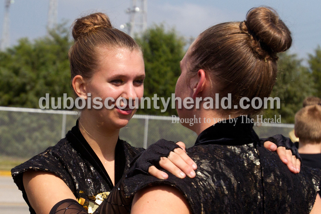 Olivia Corya/The Herald<br /> Forest Park junior Tiffany Singer, left, gave a pep talk to fellow guard member Jessica Hurm, senior, who was disappointed after a slip up in the performance at the ISSMA band districts at Jerry Brewer Alumni Stadium in Jasper on Saturday.