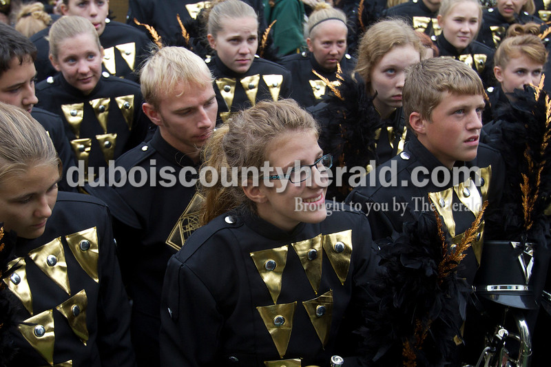 Olivia Corya/The Herald<br /> Forest Park sophomore Sydney Lange, wearing glasses, listened with the rest of the marching band to their director before competing in the ISSMA band districts at Jerry Brewer Alumni Stadium in Jasper on Saturday.