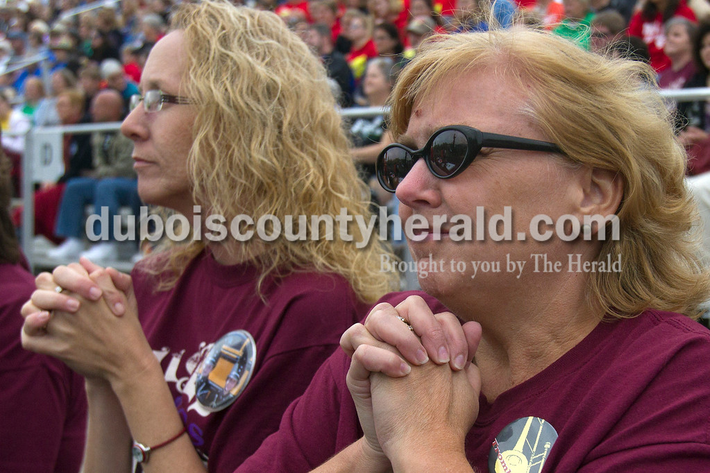 Olivia Corya/The Herald<br /> Band moms Denise Buening, left, and Judy Jochem-Nino, both of Huntingburg, watched their children compete with Southridge's marching band during the ISSMA band districts at Jerry Brewer Alumni Stadium in Jasper on Saturday.