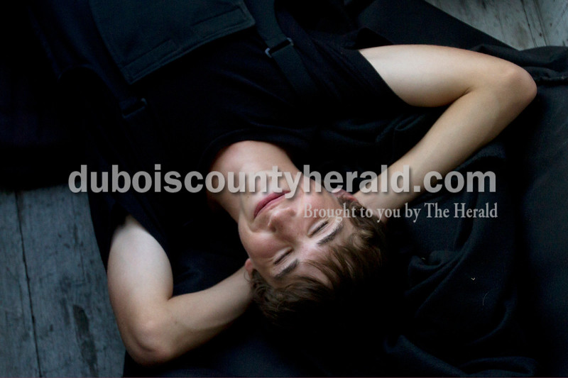 Olivia Corya/The Herald<br /> Jasper freshman Nick Freyberger rested inside the band trailer as he waited with marching band friends to compete in the ISSMA band districts at Jerry Brewer Alumni Stadium in Jasper on Saturday.