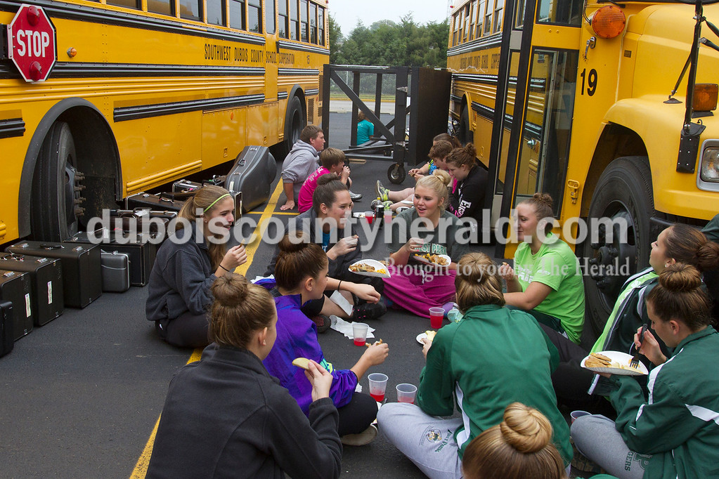 Olivia Corya/The Herald<br /> Forest Park marching band members ate lunch as they waited to compete at the ISSMA band districts at Jerry Brewer Alumni Stadium in Jasper on Saturday.