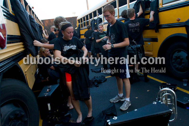 Olivia Corya/The Herald<br /> Jasper marching band members Maddie Messmer, senior, and Drew Ahner, junior, chatted as they changed out of their uniforms after competing in the ISSMA band districts at Jerry Brewer Alumni Stadium in Jasper on Saturday.