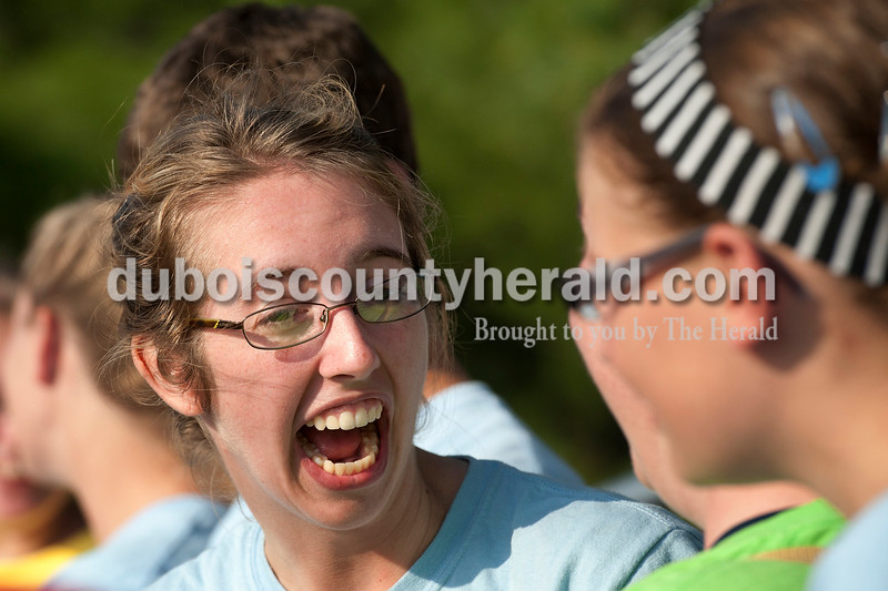 Olivia Corya/The Herald<br /> Heritage Hills senior Shelby Krutz reacted after the awards announcer misspoke about another band's prize, first saying the school won silver then correcting that to gold, during the ISSMA band districts at Jerry Brewer Alumni Stadium in Jasper on Saturday.