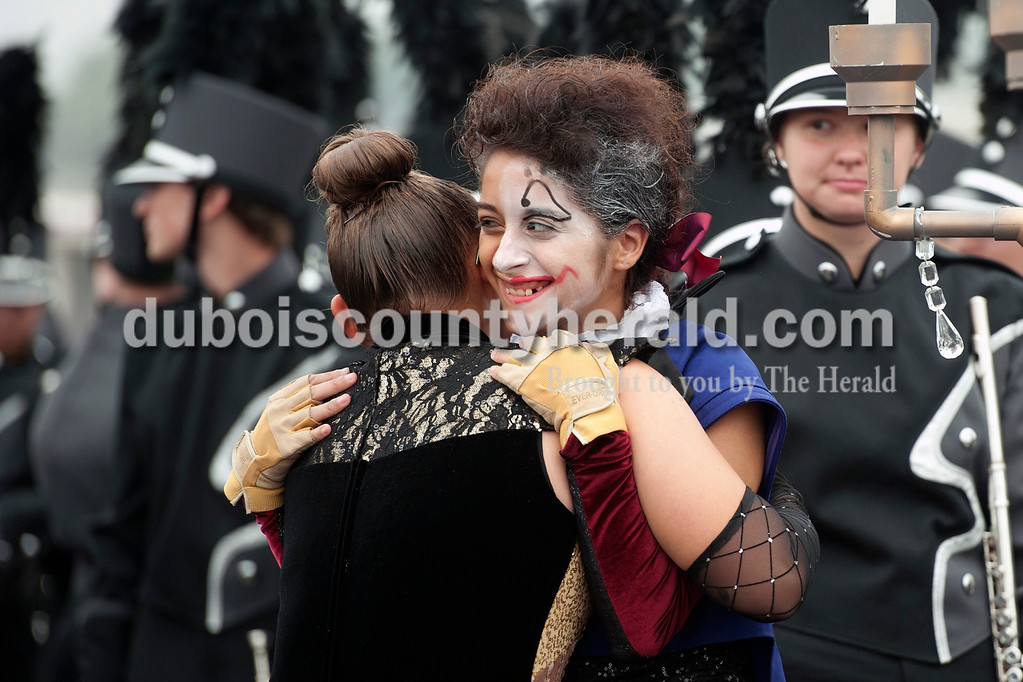 Olivia Corya/The Herald<br /> Southridge sophomore Emily Calderon received a hug from her friend Lidia Grace, a Forest Park sophomore, before their respective marching bands competed in the ISSMA band districts at Jerry Brewer Alumni Stadium in Jasper on Saturday.