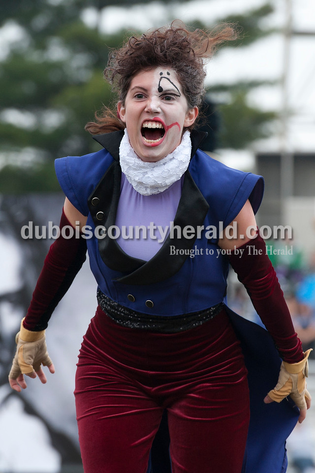 """Olivia Corya/The Herald<br /> Southridge senior and color guard member Shannon Phillips, dressed as a mad composer to fit her marching band's theme """"twisted classics,"""" performed during the ISSMA band districts at Jerry Brewer Alumni Stadium in Jasper on Saturday."""