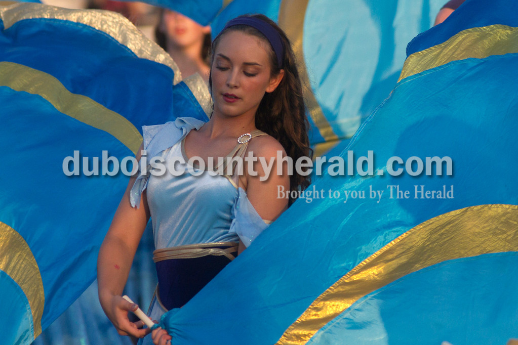 Olivia Corya/The Herald<br /> Jasper color guard member Madisyn Lehmkuhler, senior, performed with her school's marching band during the ISSMA band districts at Jerry Brewer Alumni Stadium in Jasper on Saturday.