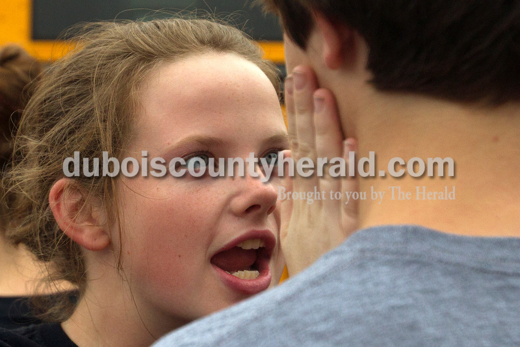 Olivia Corya/The Herald<br /> Southridge senior Harlee Ray played around with fellow marching band member Noah Rader, sophomore, smacking his cheeks as they stood around waiting to compete at the ISSMA band districts at Jerry Brewer Alumni Stadium in Jasper on Saturday.