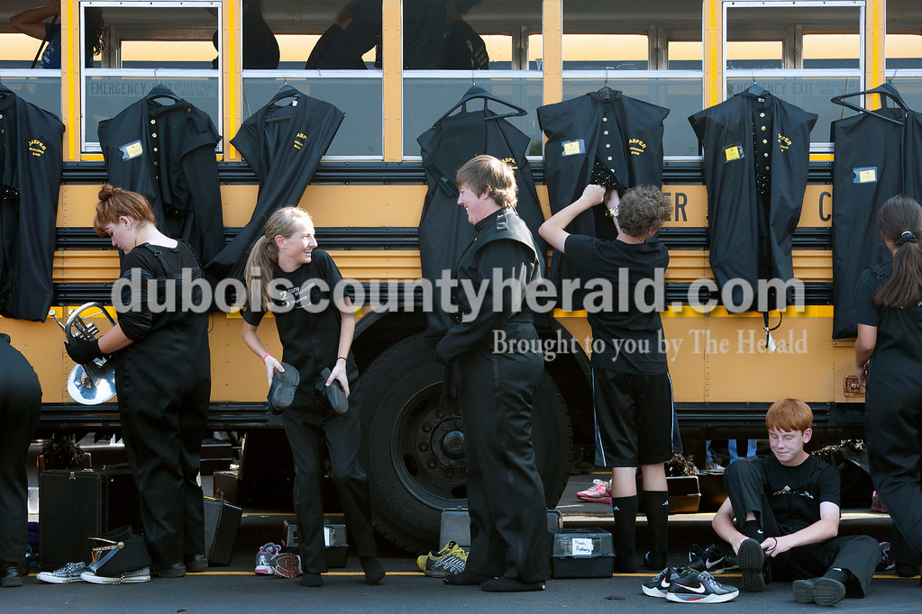 Olivia Corya/The Herald<br /> Jasper marching band members changed into their uniforms before competing at the ISSMA band districts at Jerry Brewer Alumni Stadium in Jasper on Saturday.