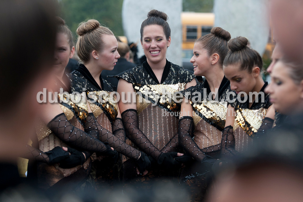 Olivia Corya/The Herald<br /> Forest Park color guard members Jessica Hurm, Rachel Hentrup, Lori Uebelhor, Geena McFaul, and Emily Nord circled up for a pep talk from one of their coaches before competing at the ISSMA band districts at Jerry Brewer Alumni Stadium in Jasper on Saturday. All girls are seniors except Emily, who is in eighth grade. Their school placed gold.