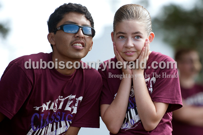 Olivia Corya/The Herald<br /> Southridge marching band members Irvin Rocha, senior, and Emma Kinker, eighth grade, watched another band perform during the ISSMA band districts at Jerry Brewer Alumni Stadium in Jasper on Saturday. Southridge's marching band includes six eighth graders.