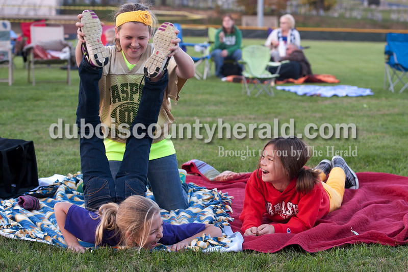 "Olivia Corya/The Herald<br /> Friends Kaitlyn Henke, Laura Gobert, and Annie Donato, left to right, played around while they waited for the movie Horton Hears a Who to start during Tenth Street Elementary's first annual ""Screen on the Green"" event behind the school on Friday evening. The girls are all from Jasper, 10 years old, and in fifth grade together at Tenth Street Elementary."