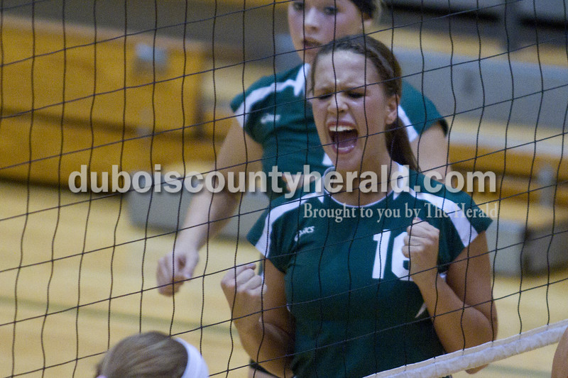 Olivia Corya/The Herald<br /> Forest Park's Katie Fischer cheered after the Lady Rangers scored a point during Tuesday's Class 2A girls volleyball sectional game against Evansville Mater Dei at Forest Park. The Rangers were defeated 3-0.