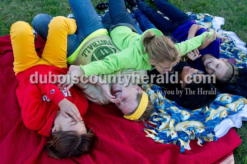 "Olivia Corya/The Herald<br /> Annie Donato, 10, Laura Gobert, 10, Kimber Schnarr, 11, and Kaitlyn Henke, 10, laughed as they were jumped on by Laura's sister Julia Gobert, 9, while they waited for the movie Horton Hears a Who to start during Tenth Street Elementary's first annual ""Screen on the Green"" event behind the school on Friday evening. All the girls live in Jasper."