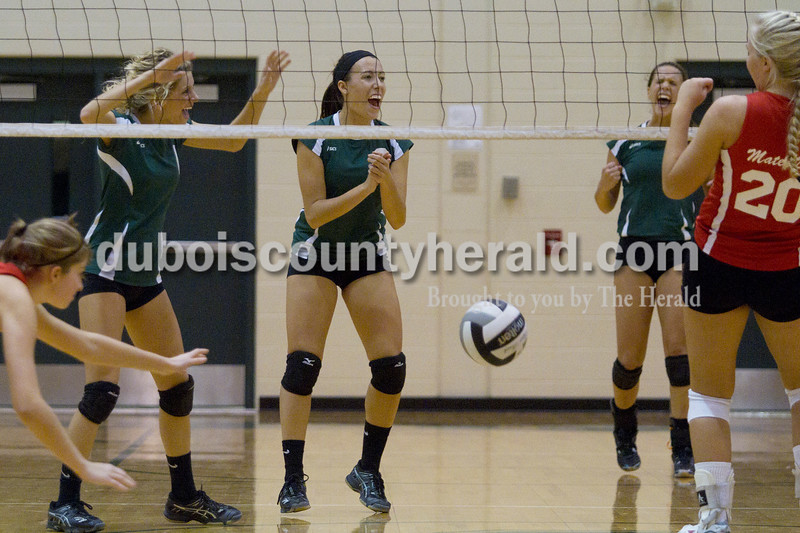 Olivia Corya/The Herald<br /> Forest Park's Sydney Berg, Chloe Dilger, and Katie Fischer, left to right, celebrated a point during Tuesday's Class 2A girls volleyball sectional game against Evansville Mater Dei at Forest Park. The Rangers were defeated 3-0.