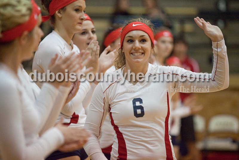 Rachel Mummey/The Herald<br /> Heritage Hills' Abby Fischer waved to the crowd during the team introductions before the start of the  Class 3A volleyball sectional championship against Jasper at Cabby O'Neill Gymnasium on Saturday.