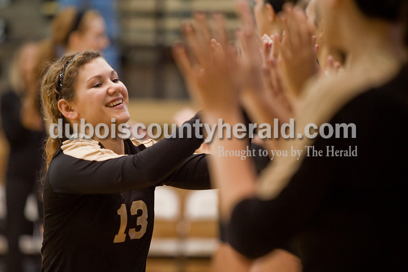 Rachel Mummey/The Herald<br /> Jasper's Mariah Moeller high-fived her teammates during the team introductions before the start of the  Class 3A volleyball sectional championship against Heritage Hills at Cabby O'Neill Gymnasium on Saturday.