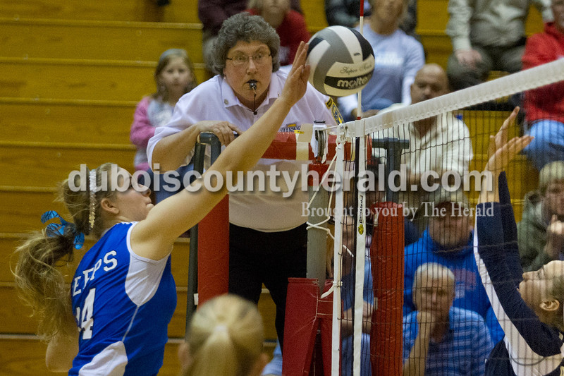 Olivia Corya/The Herald<br /> Northeast Dubois' Kendra Jacob spiked the ball during the Class 1A girls volleyball sectional championship at Tecumseh on Saturday. The Jeeps won 3-2.