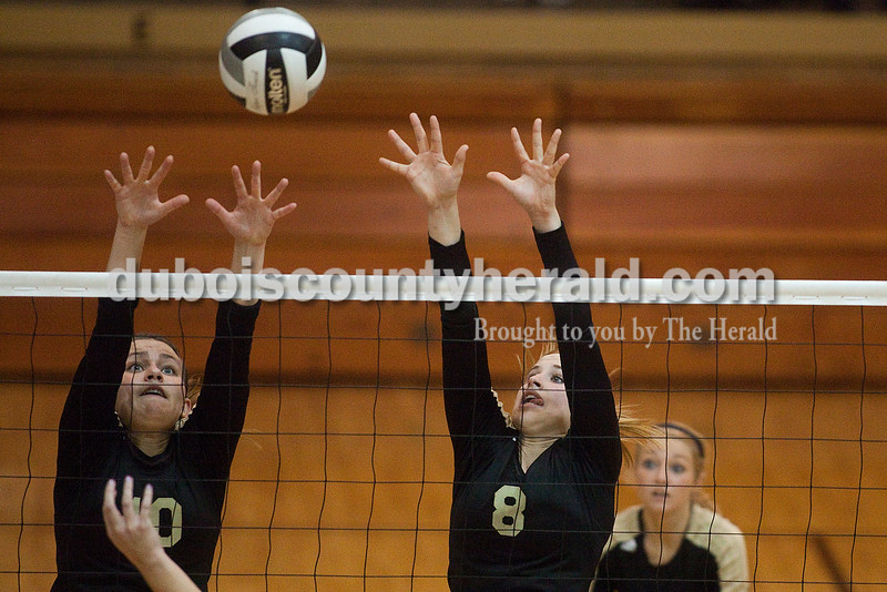 Rachel Mummey/The Herald<br /> Jasper's Megan Stenftenagel and Tori Sermersheim tried blocking the ball during the Class 3A volleyball sectional championship against Heritage Hills at Cabby O'Neill Gymnasium on Saturday.