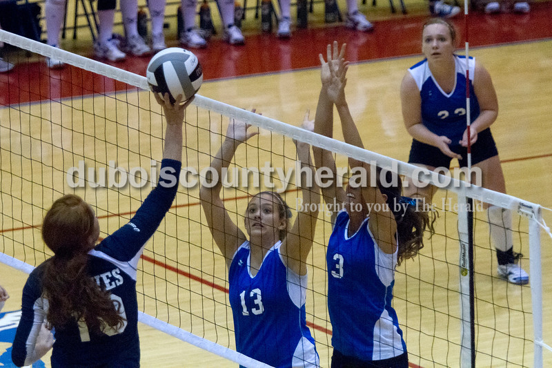 Olivia Corya/The Herald<br /> Northeast Dubois' Haley Brinkman, left, and Emily Lueken attempted to block the ball during the Class 1A girls volleyball sectional championship at Tecumseh on Saturday. The Jeeps won 3-2.