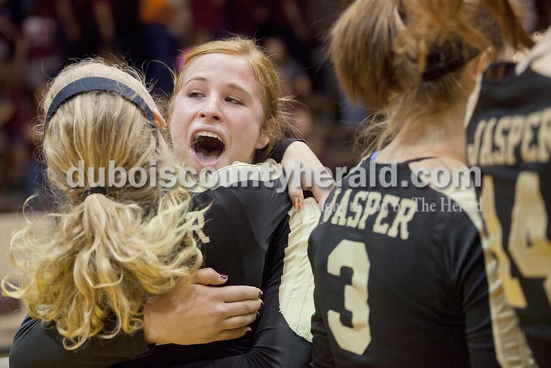 Rachel Mummey/The Herald<br /> Jasper's Tori Sermersheim hugged her teammate Lydia Scherle after they defeated Mount Vernon in the Class 3A Volleyball Regional in Mount Vernon on Tuesday. Jasper won in the fifth match 15-13.