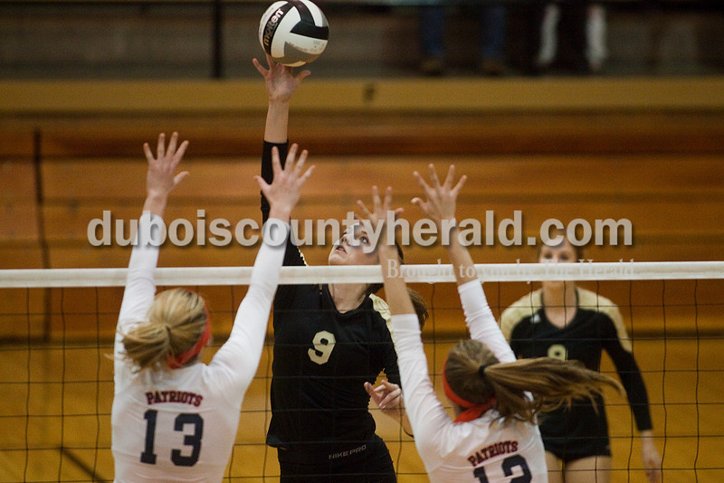 Rachel Mummey/The Herald<br /> Jasper's Shelby Merder tipped the ball over the next during the Class 3A volleyball sectional championship against Heritage Hills at Cabby O'Neill Gymnasium on Saturday.