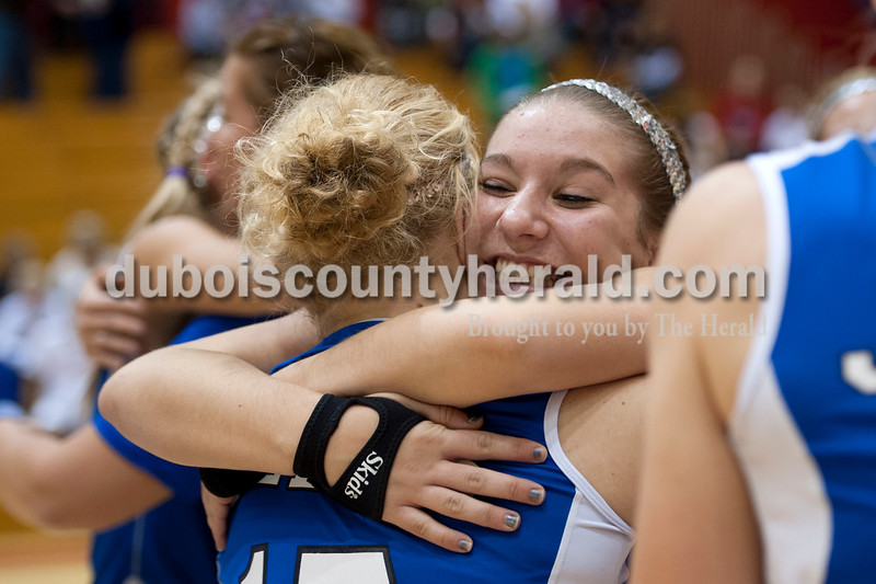 Olivia Corya/The Herald<br /> Northeast Dubois' Jenna Stemle, right, hugged teammate Michaela Stemle after they won the Class 1A girls volleyball sectional championship at Tecumseh on Saturday. The Jeeps won 3-2.