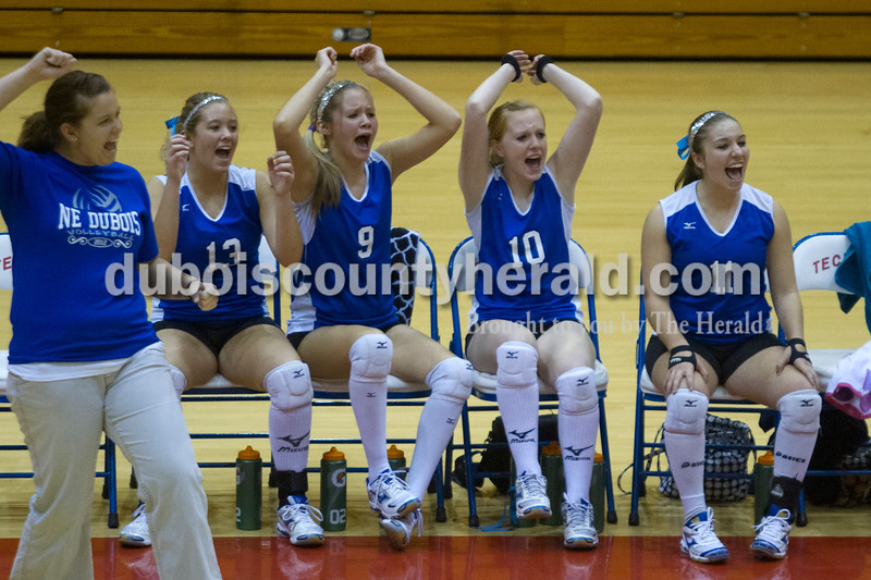 Olivia Corya/The Herald<br /> Northeast Dubois' coach Stephanie Schepers and players Haley Brinkman, Katelyn Helming, Chloe Johnson, and Jenna Stemle, left to right, reacted from the sidelines as they watched their teammates play in the Class 1A girls volleyball sectional championship at Tecumseh on Saturday. The Jeeps won 3-2.