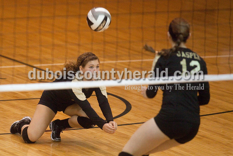 Rachel Mummey/The Herald<br /> Jasper's Mariah Moeller dove to bump the ball in the back court during their match against Heritage Hills in the Class 3A volleyball sectional championship at Cabby O'Neill Gymnasium on Saturday.